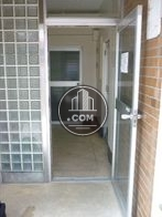アルミサッシとガラスタイルを使った正面玄関ドアです